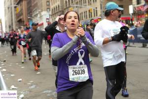 Marisa in her Project Purple gear at the NYC half-marathon