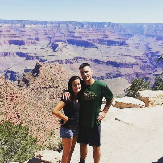 John with his daughter visiting the Grand Canyon